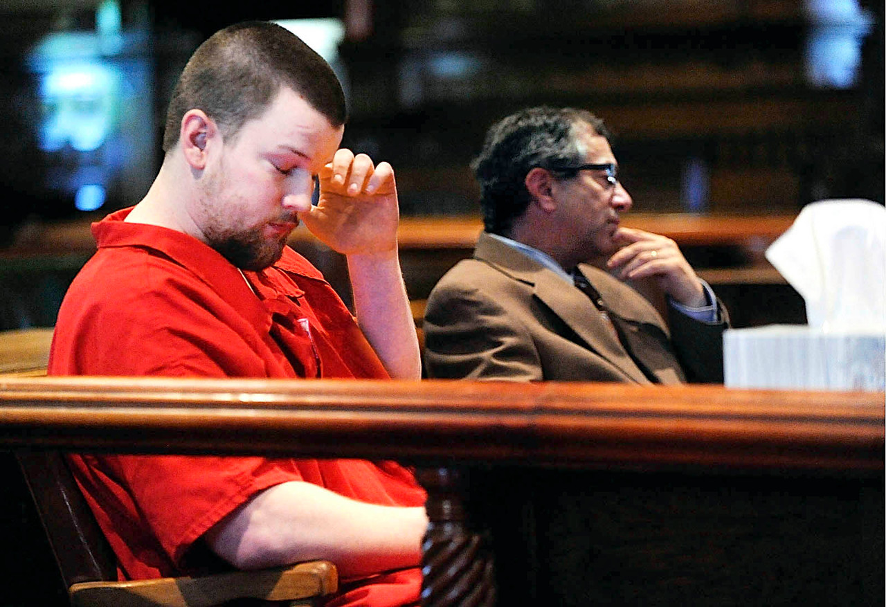 Steated next to his defense attorney, Jeffrey Silverstein, Justin Ptaszynski (left) put his head in his hand as Assistant Attorney General Andrew Benson presented sentencing recommendations after Ptaszynski entered his plea to Maine Superior Court Justice Michaela Murphy at Kennebec Superior Court in Augusta, Maine  Friday afternoon, May 21, 2010.  BANGOR DAILY NEWS PHOTO BY JOHN CLARKE RUSS