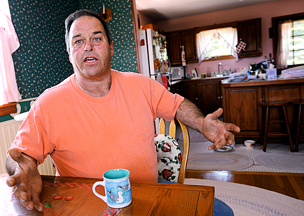 Gilbert Lemoine, father of Shaun Lemoine, sits at the family home on Swans Island on Thursday, May 21, 2010. He is concerned for his son's lobster boat- payments are due shortly and family members are pitching in to help out while Shaun Lemoine is in jail. &quotThat's the big thing with him, he's just always been in the wrong place at the wrong time or hanging out with the wrong ones,&quot said Lemoine of his son's troubles.  BANGOR DAILY NEWS PHOTO BY KEVIN BENNETT