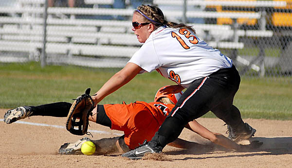 BREWER, ME --  MAY 21, 2010 -- Brewer's Kelcey Simpson is safe back at first under the tag of Skowhegan's Megan Hancock in the fourth inning of the Friday afternoon game at Brewer.  BANGOR DAILY NEWS PHOTO BY LINDA COAN O'KRESIK