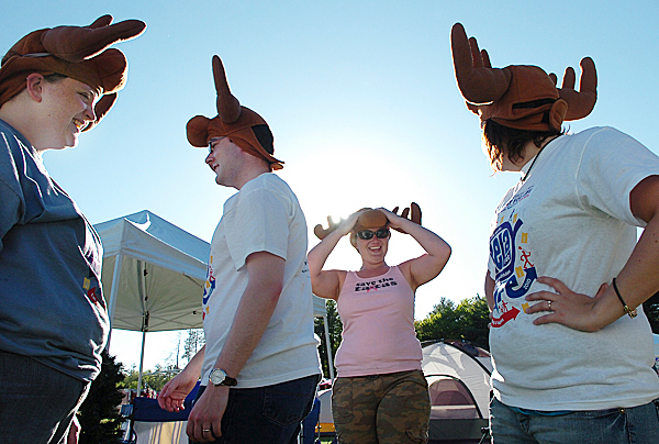 Team members of &quotMoose on the Loose&quot including (from left) Becky Perkings of Bangor, Zole Hawthorn of Bangor, Danyell Lennon of Brewer and Krystal Mores of Old Town prepare for the 17th annual Relay for Life at the Old Town High School track Friday, May 21, 2010. The team, which combined students and staff members from University College of Bangor, was one of 84 teams who participated in the event to raise money for the American Cancer Society. (Bangor Daily News/Bridget Brown)