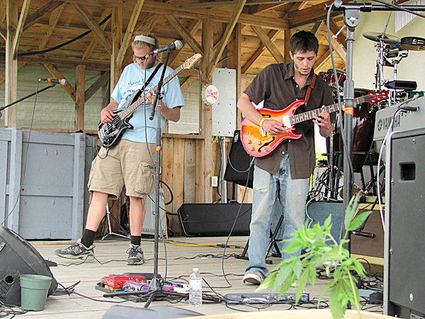 Members of improvisational rock band Nippin' the Nub jams out a tune Saturday at the Maine PeaceJam Fest in Harmony. The festival is one of several fund raisers held each year by Maine Vocals, a group that is collecting signatures for two pro-marijuana citizen initiatives.  BANGOR DAILY NEWS PHOTO BY CHRISTOPHER COUSINS