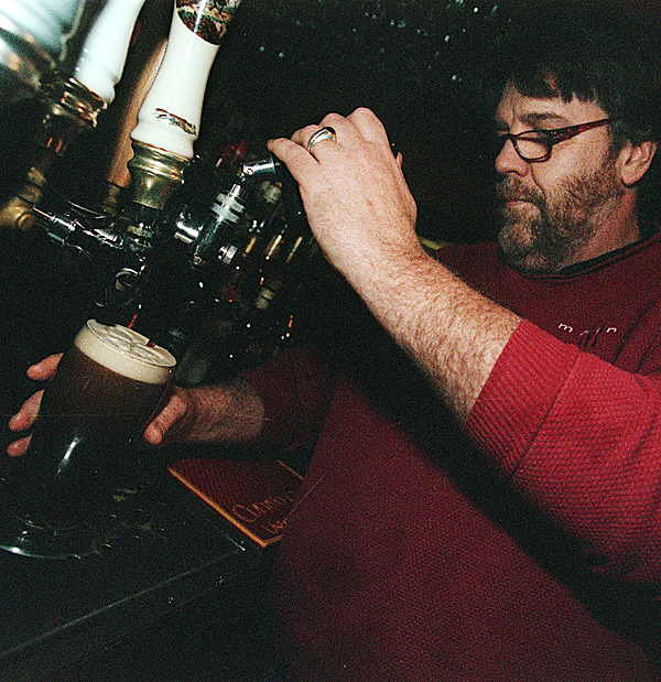 Chris Geaghan &quotbuilds&quot a perfect Guinness at his Irish pub, the Whig & Courier in Bangor. BANGOR DAILY NEWS FILE PHOTO BY MILLER PEARSALL