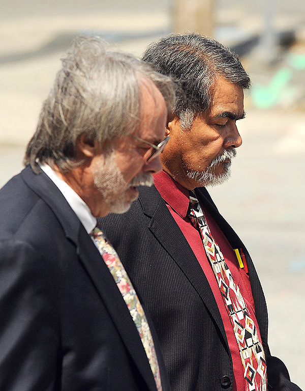 Benjamin J. Guiliani Sr. of South Portland (right) and his attorney Bruce Merrill leave the U.S. Disctrict Court in Bangor Tuesday.  Guiliani pled guilty on five charges that include transporting and harboring illegal alians.  BANGOR DAILY NEWS PHOTO BY GABOR DEGRE