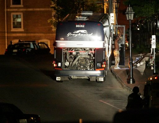 A passenger on a Maine-to-New York Greyhound bus surrenders to authorities after a nine-hour standoff sparked by a bomb scare in Portsmouth, N.H., Thursday, May 6, 2010.  (AP Photo/Jim Cole)
