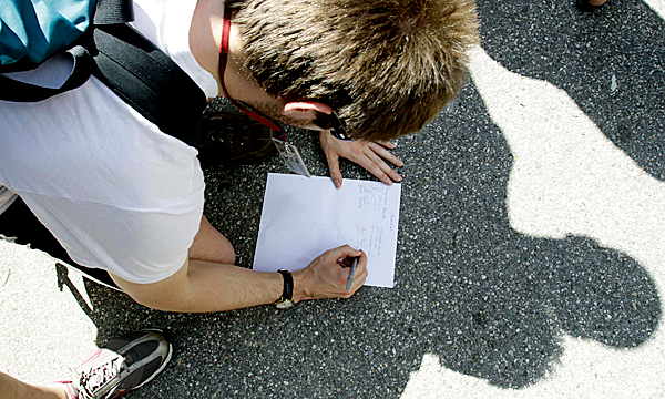 A student signs a petition where fellow students gathered at Bates College in Lewiston, Maine on Wednesday, May 26, 2010.  An incident involving students being arrested occurred the night before, where some students claim they were injured by police actions. ( AP Photo/Pat Wellenbach)