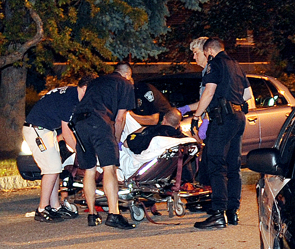 In this Wednesday, May 26, 2010 photo, Lewiston police officer Robert Ullrich is loaded onto a stretcher with a broken leg suffered during an altercation with Bates College students early Wednesday morning following a fracas on the Lewiston, Maine, campus. (AP Photo/Sun Journal, Russ Dillingham) MAGS OUT; NO SALES