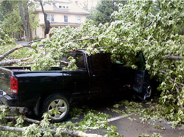 A woman and her three children escaped serious injury on Court Street in Houlton on Tuesday afternoon after three trees that were felled during a fast moving storm fell on top of their vehicle. The trees crushed the hood and roof of the Dodge Ram four-door truck and heavily damaged the rest of the vehicle. Arootook County took the brunt of the damage from a line of thunderstorms that moved through parts of the state at around 3 p.m., bringing rain and wind to the area and sending trees crashing down on to roadways and power lines. (PHOTOS COURTESY OF THE HOULTON POLICE DEPARTMENT) w/LYNDS STORY, 3 col max