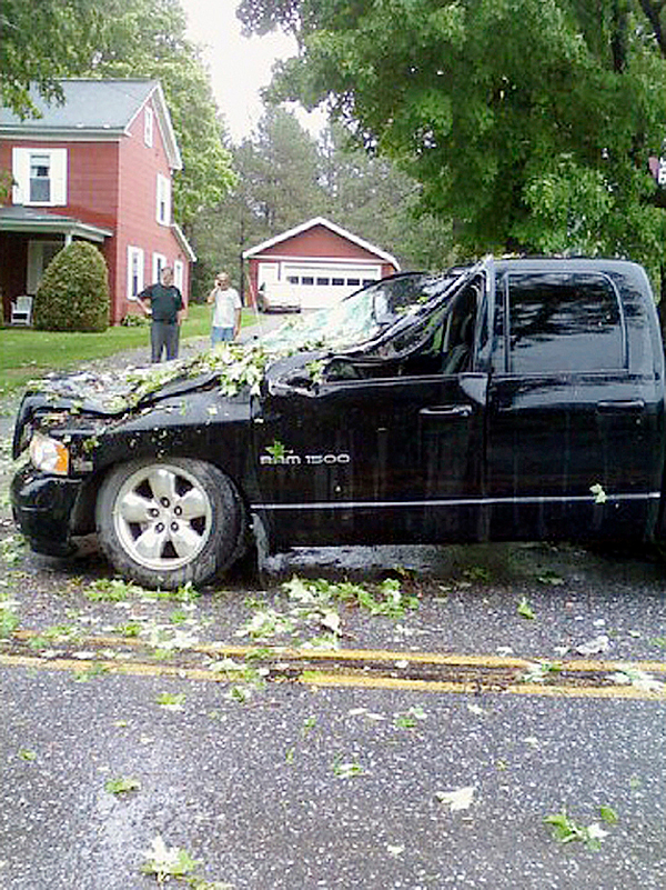 A woman and her three children escaped serious injury on Court Street in Houlton on Tuesday afternoon after three trees that were felled during a fast moving storm fell on top of their vehicle. The trees crushed the hood and roof of the Dodge Ram four-door truck and heavily damaged the rest of the vehicle. Arootook County took the brunt of the damage from a line of thunderstorms that moved through parts of the state at around 3 p.m., bringing rain and wind to the area and sending trees crashing down on to roadways and power lines. (PHOTOS COURTESY OF THE HOULTON POLICE DEPARTMENT) w/LYNDS STORY, 2 col max