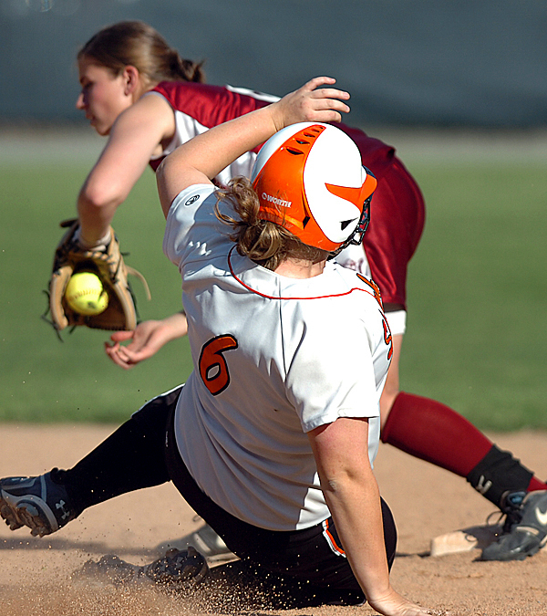 Skowhegan's Anna Lorrette (6) slides towards second but was tagged out by Bangor short stop Moriah Caisum in the sixth inning of Wednesday's game, May 26, 2010 in Bangor. BANGOR DAILY NEWS PHOTO BY BRIDGET BROWN