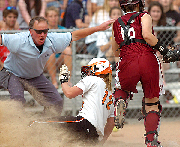 Skowhegan's Whitney Jones (12) slides safely into home ahead of a tag from Bangor catcher Jeri Cosgrove in the seventh inning of Wednesday's game, May 26, 2010 in Bangor. BANGOR DAILY NEWS PHOTO BY BRIDGET BROWN