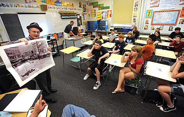 Local historian Dick Shaw, left, shows an image of gangster Al Brady, dead on Central Street in 1937, to Ron Biliancia's 7th grade social studies class at the William Cohen school on Thursday, May 27, 2010. Shaw along with Dan West, car buff, were on hand to help students determine how to sort out the historical clues from photographs . The class was shown two different images of a car similar to Brady's stolen ride and were asked to take visual clues from them to determine if either of the images was of the infamous gang's car.  BANGOR DAILY NEWS PHOTO BY KEVIN BENNETT