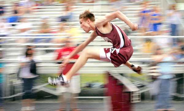 George Stevens Academy's Ben Plohr sails over the hurdles en route to a first place finish in the 100 meter hurdles Saturday, may 29, 2010, in Dover Foxcroft.  BANGOR DAILY NEWS PHOTO BY MICHAEL C. YORK
