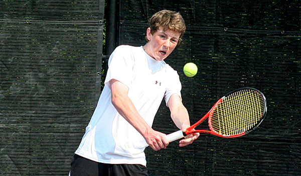 Bob Tom Flynn, of John Bapst High School in Bangor, connects on a backhand shot in his Round-of-16 matchup against Mt. Ararat High School's Adam Levesque at the Wallach Tennis complex on the campus of Bates College in Lewiston on Saturday. Flynn won the match, 6-3, 6-0.  SUN JOURNAL PHOTO BY JUSTIN PELLETIER