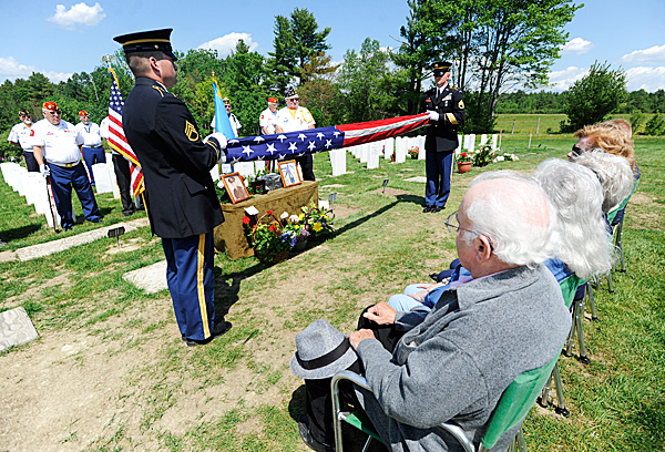 Staff Sgt. Norman Voter, left, of Auburn and Staff Sgt. Christopher McBean of Farmindale, members of the Maine Military Funeral Honors Program,  fold a U.S. flag before presenting it to the family of Clyde Hinkley (cq) during Hinkley's funeral at Maine Veterans' Cemetery in Augusta Wednesday, May 26, 2010.  Hinkley  served in the U.S. Army from 1956-1958. Behind them were members of the Kennebec County Veterans' Honor Guard.  BANGOR DAILY NEWS PHOTO BYJOHN CLARKE RUSS