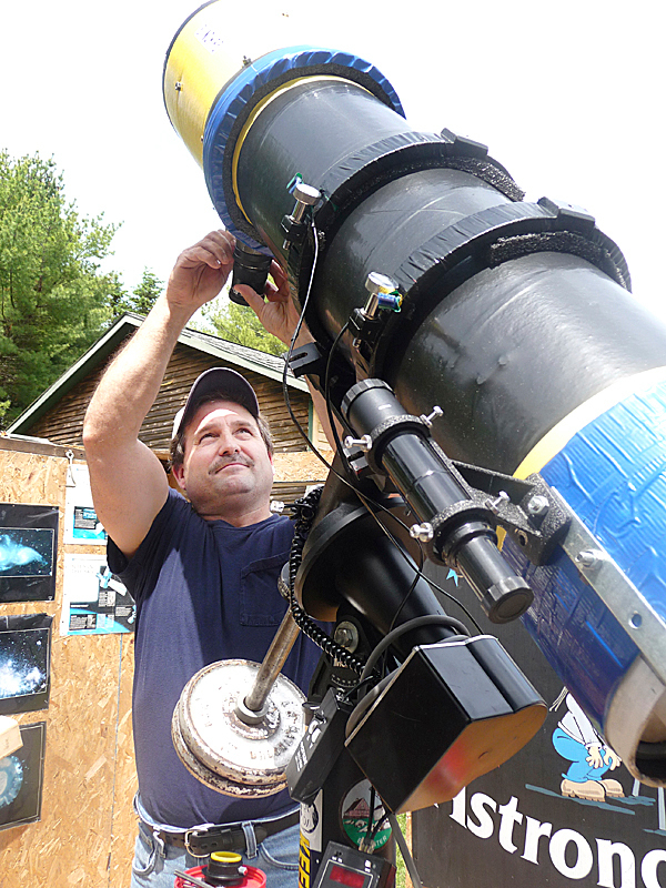 Charlie Sawyer of Pembroke adjusts his homemade telescope. Sawyer has an observatory with a retractable roof that he uses for classes, workshops and the Down East Amateur Astronomers, a local club. &quotOn a moonless night in Maine, when the sky is clear, it is incredible,&quot Sawyer said.   BANGOR DAILY NEWS PHOTO BY SHARON KILEY MACK