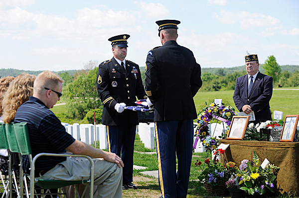 Staff Sgt. Norman Voter, left, of Auburn and Staff Sgt. Christopher McBean of Farmingdale, members of the Maine Military Funeral Honors Program,  fold a U.S. flag before presenting it to the family of Clyde Hinkley (cq) during Hinkley's funeral at Maine Veterans' Cemetery in Augusta Wednesday, May 26, 2010.  Hinkley  served in the U.S. Army from 1956-1958. On the right was Lu Lamoreau (cq), a chaplain with the Kennebec County Veterans Honor Guard.  BANGOR DAILY NEWS PHOTO BY JOHN CLARKE RUSS