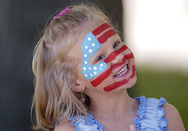 With the help of her mother Phoenicia Goodwin and a little craft paint, five-year-old Grace Goodwin of Brewer showed her pride on her face while watching the Memorial Day goings on at Davenport Park Monday morning. BANGOR DAILY NEWS PHOTO BY JOHN CLARKE RUSS