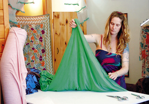 Jessi Sader measures fabric for a dress at her store and working space called Studio on Main Street in Orono on Thursday, May 27, 2010. Studio carries a variety of Sader's creations, labeled as FX Dressed, along with other clothing and gifts made by individuals in the U.S. or Canada. BANGOR DAILY NEWS PHOTO BY BRIDGET BROWN