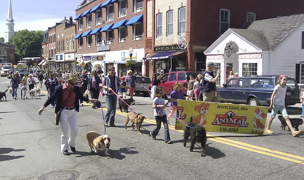 Members of the Camden-Rockport Animal Rescue League march along Main Street Monday in Camden's annual Memorial Day Parade. The parade, sponsored by American Legion Post #30, also featured antique autos, the Camden Hills High School marching band, fire trucks, a military color guard, and American Legion members. BANGOR DAILY NEWS PHOTO BY BILL TROTTER