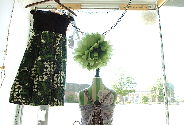 Summer dresses made by Jessi Sader hang in the windows of Studio on Main Street in Orono on Thursday, May 27, 2010. BANGOR DAILY NEWS PHOTO BY BRIDGET BROWN