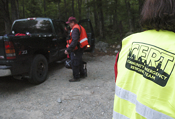 Most searchers wear bright yellow or orange vests to help missing hikers find them and to keep themselves from getting lost in the thick woods that cover most of Baxter State Park. BANGOR DAILY NEWS PHOTO BY NICK SAMBIDES JR.