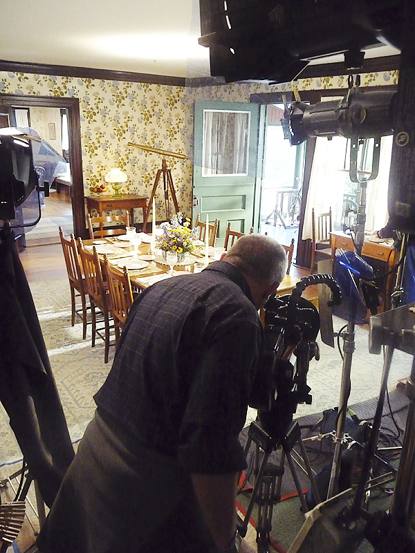 Filmmaker Paul Barnes sets up a shot in the dining room of the Roosevelt Cottage at Roosevelt International Park. Florentine Films was at the park all last week, filming scenes for a biography of the relationship between Eleanor, Franklin and Theodore Roosevelt. Scenes were shot inside the cottage and around the park, such as a sunrise at Eagle Hill.  BANGOR DAILY NEWS PHOTO BY SHARON KILEY MACK