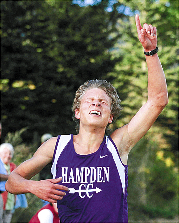 Hampden Academy senior Darik Frye celebrates as he crosses the finish line to win the boys' race in a three-team Kennebec Valley Athletic Conference cross country meet at Hampden Friday. Frye covered the 2.84-mile course in 15 minutes, 6.77 seconds. The Hampden Academy boys and the Brewer girls captured the team races. BANGOR DAILY NEWS FILE PHOTO BY GABOR DEGRE