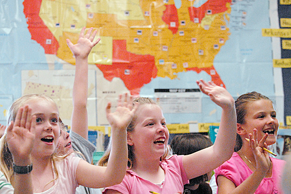 Left to right: Washington Street School third-graders including  Anna Spaulding, 9, Alli Cottrell (cq), 9 and Libby Hewes (cq), 9,  wave goodbye to Massachusetts third-graders as their class logs off from video chatting with them Tuesday, June 1, 2010. Cherrie MacInnes' third grade class at Washington Street School started &quotChatting Across America&quot earlier this year and has now visited a third grade class in 50 states via video-conferencing. They visited their last state, Massachusetts, on Tuesday. BANGOR DAILY NEWS PHOTO BY JOHN CLARKE RUSS
