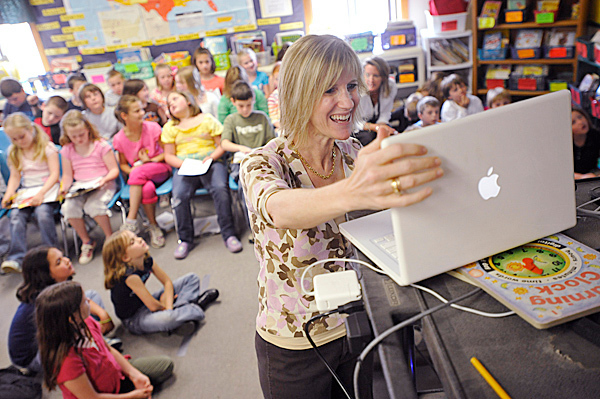Washington Street School third grade teacher Cherrie MacInnes  (foreground)  was excited as her class' laptop linked up with a Massachustts third grade class for a video chat Tuesday morning .  MacInnes' class started &quotChatting Across America&quot earlier this year and has visited a third grade class in 50 states via videoconferencing. They visited their last state, Massachusetts on Tuesday. BANGOR DAILY NEWS PHOTO BY JOHN CLARKE RUSS