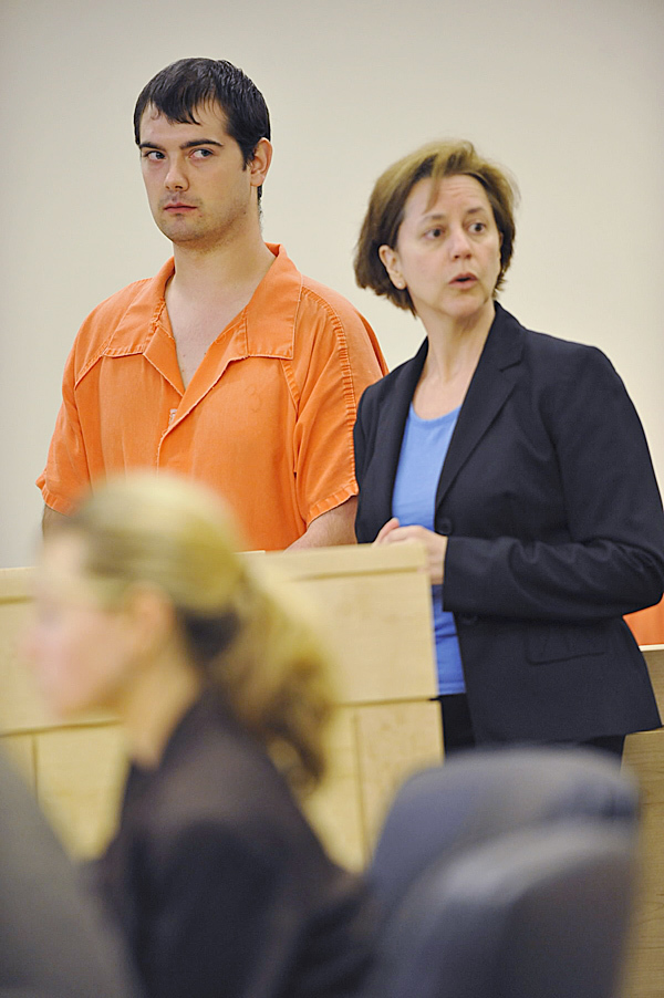 James Gregory Frank, 23, of Brewer and his attorney Carolyn Adams momentarily turn their attention towards the gallery during Frank's initial appearance at Penobscot Judicial Center Tuesday, June 1, 2010. Frank was arrested on Friday and charged with aggravated assault on his infant child. BANGOR DAILY NEWS PHOTO BY JOHN CLARKE RUSS