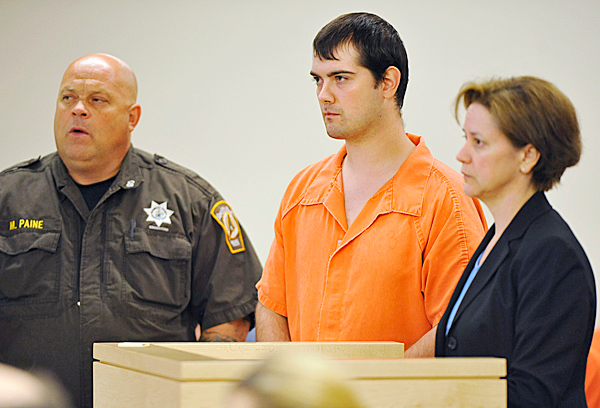 Represented by Bangor attorney Carolyn Adams (right),  James Gregory Frank, 23, of Brewer made his initial appearance at Penobscot Judicial Center Tuesday, June 1, 2010.  On the left was Penobscot County transport officer Mark Paine. Frank was arrested on Friday and charged with aggravated assault on his infant child. BANGOR DAILY NEWS PHOTO BY JOHN CLARKE RUSS