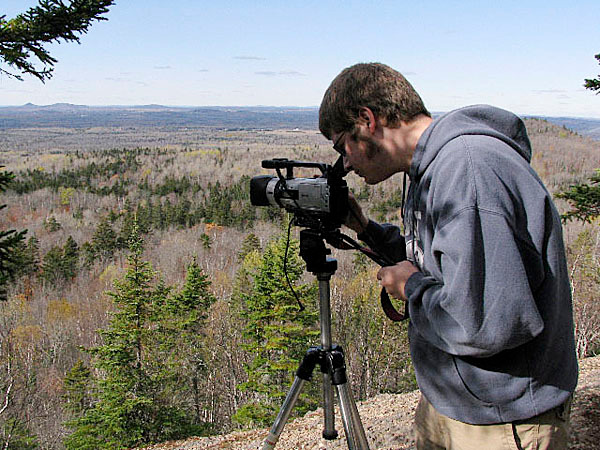 Jeff Johnson,a senior at Presque Isle High School, films from the top of the North Peak at Aroostook State Park for the Viking Video Production&quotAroostook State Park - Maine's Oldest&quot Viking Video Productions, the media studies program at the Caribou Technology Center, has been eliminated, and the program's instructor is pushing for the raw footage filmed by students in the class to be preserved with a regional film archives located in Bucksport. (PHOTO COURTESY OF BRENDA JEPSON) Lynds &quotNOCLASS&quot story