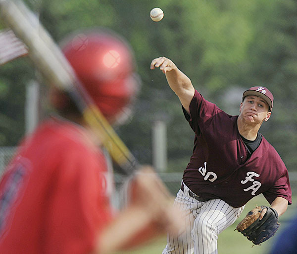 Foxcroft Academy pitcher Jon Champeon, (30), delivers a pitch in the third inning of their game versus Penquis of Milo in Dover Foxcroft, Wed., June 2, 2010. BANGOR DAILY NEWS PHOTO BY MICHAEL C. YORK