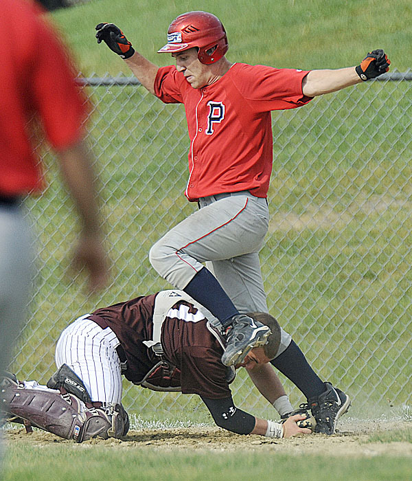 FOxcroft ACademy catcher Cody Coiley, (33), holds onto the ball as he makes the tag on Penquis' Eddie Cobb ,(5), at the plate in the fourth inning of their game in Dover Foxcroft, Wed., June 2, 2010. BANGOR DAILY NEWS PHOTO BY MICHAEL C. YORK