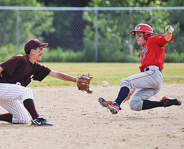 Foxcroft Academy second baseman Ryan Rebar, (6), takes the throw to tag out Penquis' Jessie McLaughlin, (1), at second on a steal attempt in the second inning of their game in Dover Foxcroft, Wed., June 2, 2010. BANGOR DAILY NEWS PHOTO BY MICHAEL C. YORK