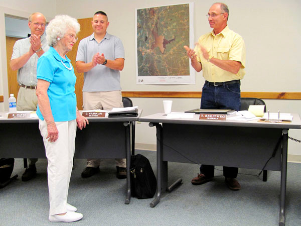 Members of the Newport Board of Selectmen applaud Dolores &quotDot&quot Fernald Wednesday night after presenting her with a certificate of appreciation for some 25 years of service as an election clerk for the town. BANGOR DAILY NEWS PHOTO BY CHRISTOPHER COUSINS