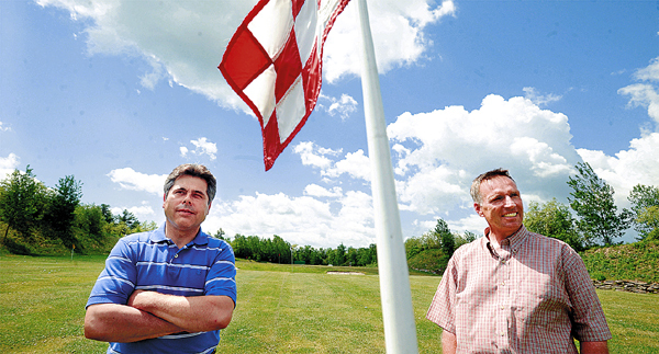 Dennis Payson (left) and Colin Gillies new co-owners of the Traditions Golf Club in Holden. BANGOR DAILY NEWS PHOTO BY GABOR DEGRE