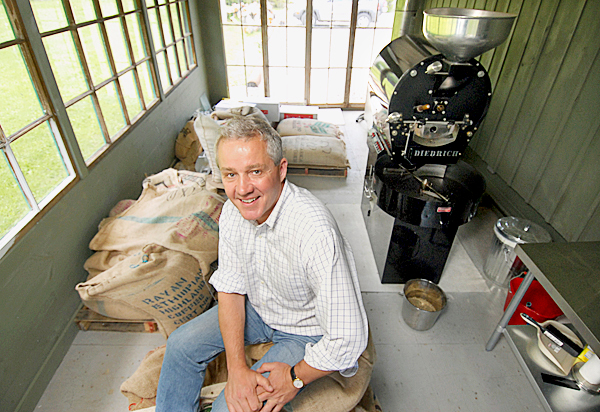 John Ostrand of Green Tree Coffee and Tea on 2456 Atlantic Highway in Lincolnville.  The store opened earlier this year. Behind him on the right is the large roaster he uses for coffee beans imported from around the globe.  BANGOR DAILY NEWS PHOTO BY JOHN CLARKE RUSS