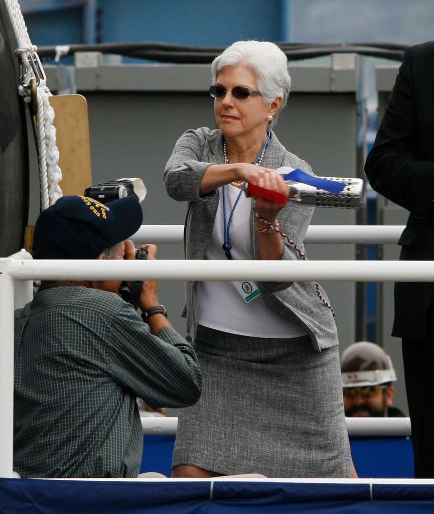 Ellen Spruance Holscher, granddaughter of Adm. Raymond Ames Spruance, swings a champagne bottle during the christening ceremony of Spruance on Saturday, June 5, 2010 at Bath Iron Works in Bath, Maine.  The 9,200-ton Aegis destroyer bears the name of Raymond Spruance  who commanded a battle group with two of three U.S. aircraft carriers whose warplanes sank four Japanese carriers at the Battle of Midway, hailed as the turning point in World War II in the Pacific.  (AP Photo/Joel Page)