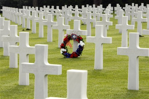 A wreath is laid on the tomb of US soldier Edward M. Withers, from Wisconsin, who died on July 12, 1944, at the Colleville US cemetary, western France, Sunday June 6, 2010, on the 66th anniversary of the D-Day. (AP Photo/Remy de la Mauviniere)