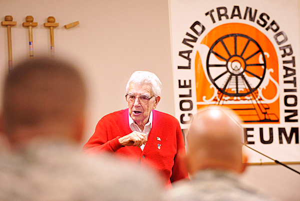 Before a special ceremony at the Cole Land Transportation Museum in Bangor, museum founder and World War II veterans Galen Cole talked with approximately 50 combat veterans to traveled to the museum to receive maple walking sticks with markings to indicate their combat service.  The recipients have all served with the Maine Army National Guard. BANGOR DAILY NEWS PHOTO BY JOHN CLARKE RUSS
