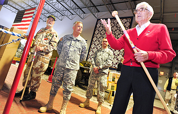 During a special ceremony  at the Cole Land Transportation Museum in Bangor, museum founder and World War II veterans Galen Cole, right, thanks the approximately 50 combat veterans to traveled to the museum to receive maple walking sticks with markings to indicate their combat service.  The recipients have all served with the Maine Army National Guard.  Next to Cole (from left) were Vietnam and Desert Storm veteran Gordon Warner (U.S. Army-retired) of Levant (who helped Cole present the walking sticks), Brigadier General Brent Boyles and Command Sgt. Terrence Harris--both with Joint Forces headquarters for the Maine Army National Guard in Augusta.  Brigadier General Boyles and Command Sgt. Harris were among the soldiers who received the honorary walking sticks.  BANGOR DAILY NEWS PHOTO BY JOHN CLARKE RUSS