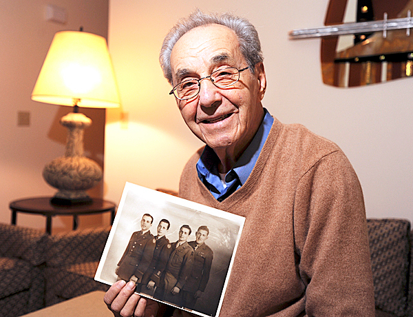 Lester Cohen of Bangor holds a picture of himself (second from right) with his three brothers (from left), Sam, Bernard and George, in uniform during World War II.  BANGOR DAILY NEWS FILE PHOTO BY KEVIN BENNETTCAPTIONLester Cohen poses at his Bangor home on Monday, November 9, 2009 with a picture of his three brothers, left to right, Sam, Bernard, Lester and George, in uniform during WWII.  (Bangor Daily News/Kevin Bennett)