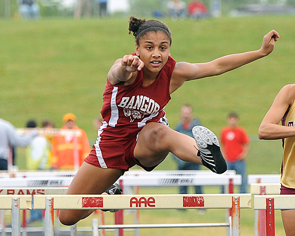 Bangor High School's Denae Johnson clears the last hurdle during the girls 100 meter hurdles at the Class A State Track Meet at Cony High School in Augusta Saturday.  Johnson won the race with the time 15.29 seconds.  BANGOR DAILY NEWS PHOTO BY GABOR DEGRE