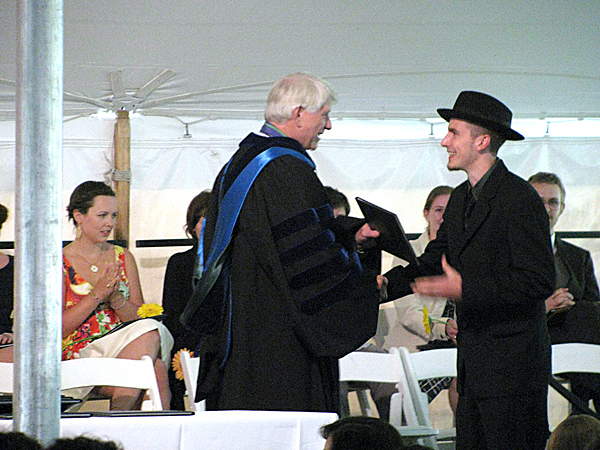 BAR HARBOR - College of the Atlantic President David Hales hands a diploma Saturday to graduating student Thomas Andrew Ceranic of Pittsburgh, Penn. Seventy students received degrees in human ecology.  BANGOR DAILY NEWS PHOTO BY ABIGAIL CURTIS