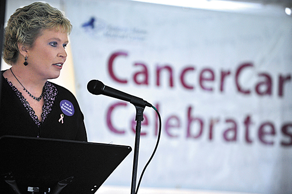 Barbara Ford of Winterport relates her personal experience with breast cancer as she speaks to fellow cancer survivors and others during Eastern Maine Medical Center's CancerCare of Maine annual Cancer Survivor Day celebration on Bangor's waterfront Sunday, June 6, 2010.  BANGOR DAILY NEWS PHOTO BY JOHN CLARKE RUSS