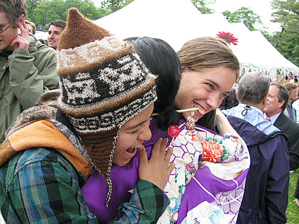 BAR HARBOR - Undergraduate students Andrea Molina, left, and Marketa Doubnerova, right, congratulate new College of the Atlantic graduate Ai Kitazumi of Osaka, Japan.  BANGOR DAILY NEWS PHOTO BY ABIGAIL CURTIS