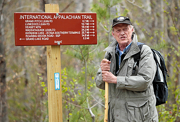 In this May 7, 2010 photo, International Appalachian Trail founder Dick Anderson of Portland, Maine, speaks to a reporter on the trail in Township 5, Range 8, Maine. The IAT begins near Mount Katahdin, the northern terminus of the Appalachian Trail, and continues through Canada's maritime provinces. A coalition of trail clubs is working to extend the trail by following the Appalachian mountain range into Europe. (AP Photo/Robert F. Bukaty)