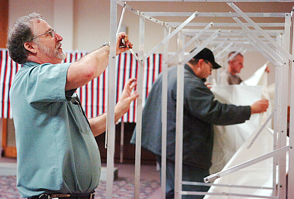 Carey &quotBuz&quot Small (left), Ed Glidden and Ross Miller erect voting booths at the Bangor Civic Center on Monday, June 7, 2010 in preparation for today's primary election. In addition to voting for gubernatorial, other state and local candidates, voters will also decide on four bond issues and a people's veto proposal to repeal an overhaul of Maine's tax code. Polls at the Bangor Civic Center open at 7 a.m. and close at 8 p.m. BANGOR DAILY NEWS PHOTO BY BRIDGET BROWN