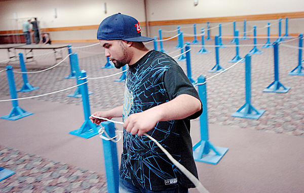 Jay Torres strings ropes for voting lines at the Bangor Civic Center on Monday, June 7, 2010 in preparation for today's primary election. In addition to voting for gubernatorial, other state and local candidates, voters will also decide on four bond issues and a people's veto proposal to repeal an overhaul of Maine's tax code. Polls at the Bangor Civic Center open at 7 a.m. and close at 8 p.m. BANGOR DAILY NEWS PHOTO BY BRIDGET BROWN